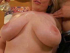 big oiled natural breasts and a hard dick between them