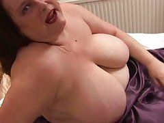 mature lady masturbating right on her bed