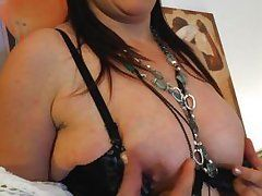 european mature alyna likes to squeeze her hard nipples