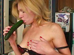 MILF plays with her food