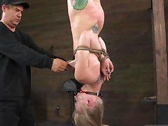 hanged cutie whipped until her butt turns red