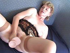 lascivious grandma masturbating with a biggest penis stimulator