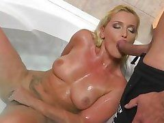 blonde washing her bear pussy gets a prick in her mouth